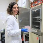 Aurélia Faure holding cell cultures.